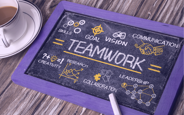A blackboard with teamwork elements.