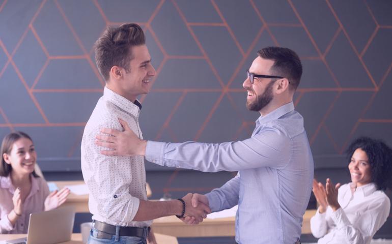 Team lead congratulating an employee.