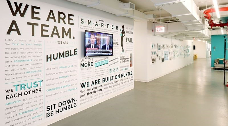 Wall at Skimm offices with quotes.