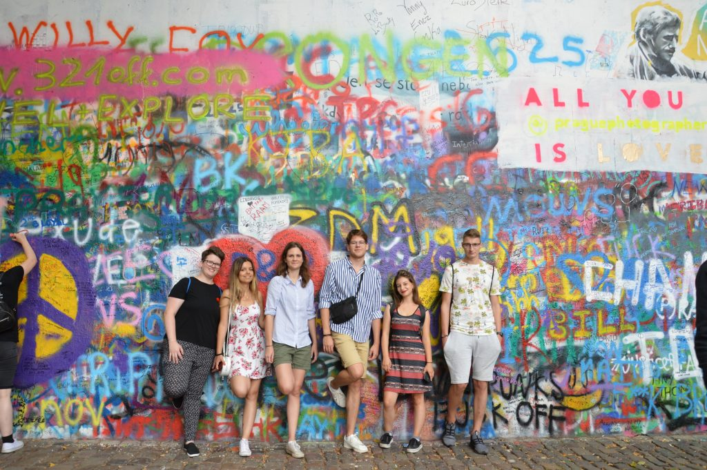 The team in front of the Lennon wall in Prague.