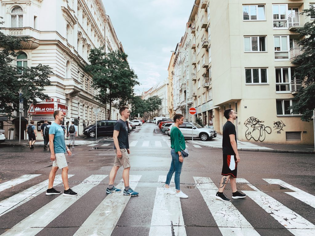 Team Four crossing the street like the Beatles.