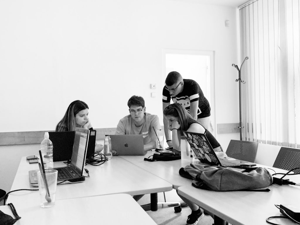Team three working in the co-working space.